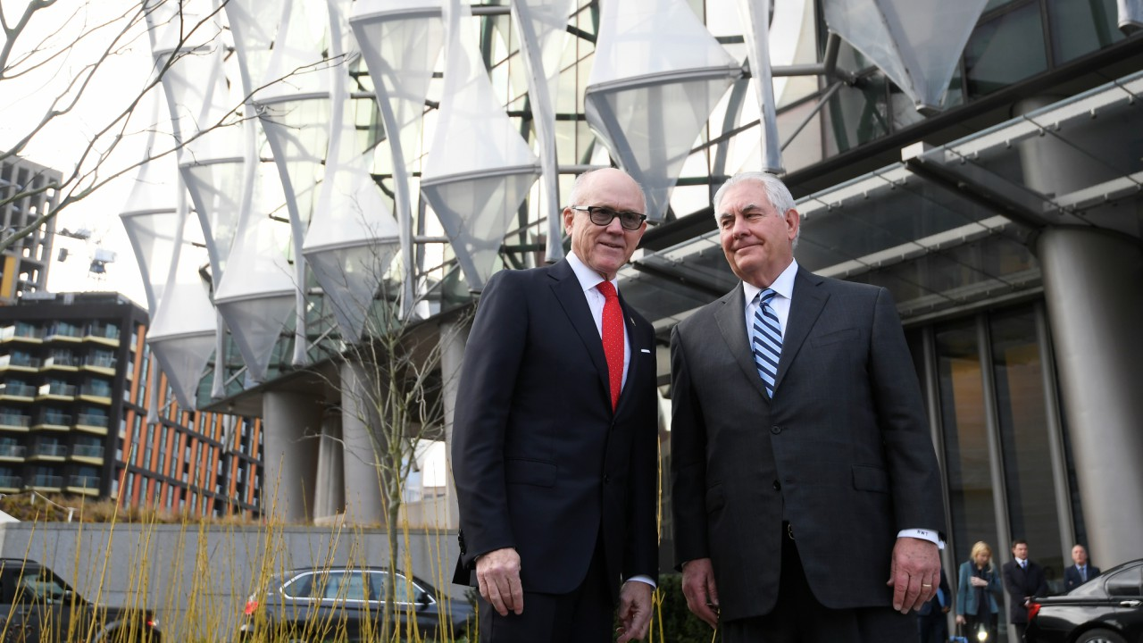 U.S. Secretary of State Rex Tillerson and Woody Johnson, U.S. ambassador to Britain stand outside the new U.S. embassy in London. (REUTERS)