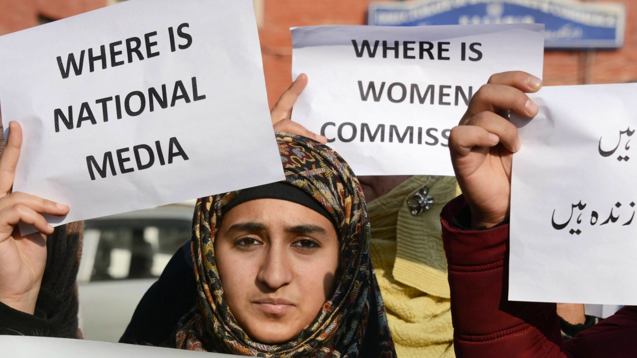 Students holding placards during a protest against the rape and murder of a 7-year old, at Lal Chowk in Srinagar (PTI)
