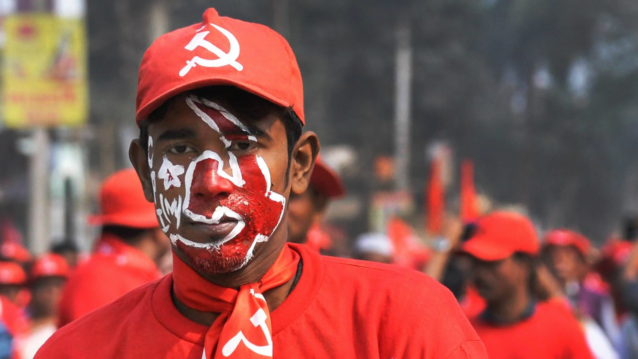 CPI(M) supporter during a mass rally as Tripura power minister Manik Dey submits a nomination for Tripura Assembly election in Jirania. (PTI)