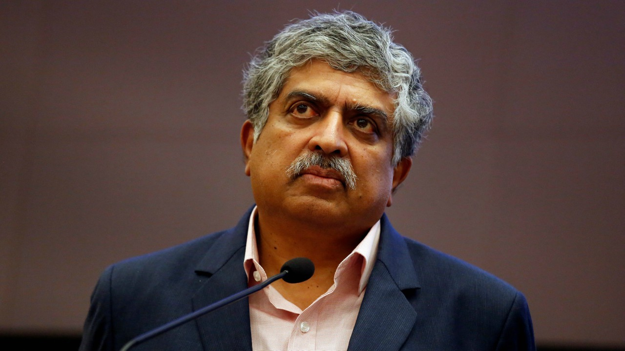 Nandan Nilekani, Co-founder and Non-Executive Chairman of Infosys, listens to reporters' questions during the announcement of the company's quarterly results at its headquarters in Bengaluru. (REUTERS)