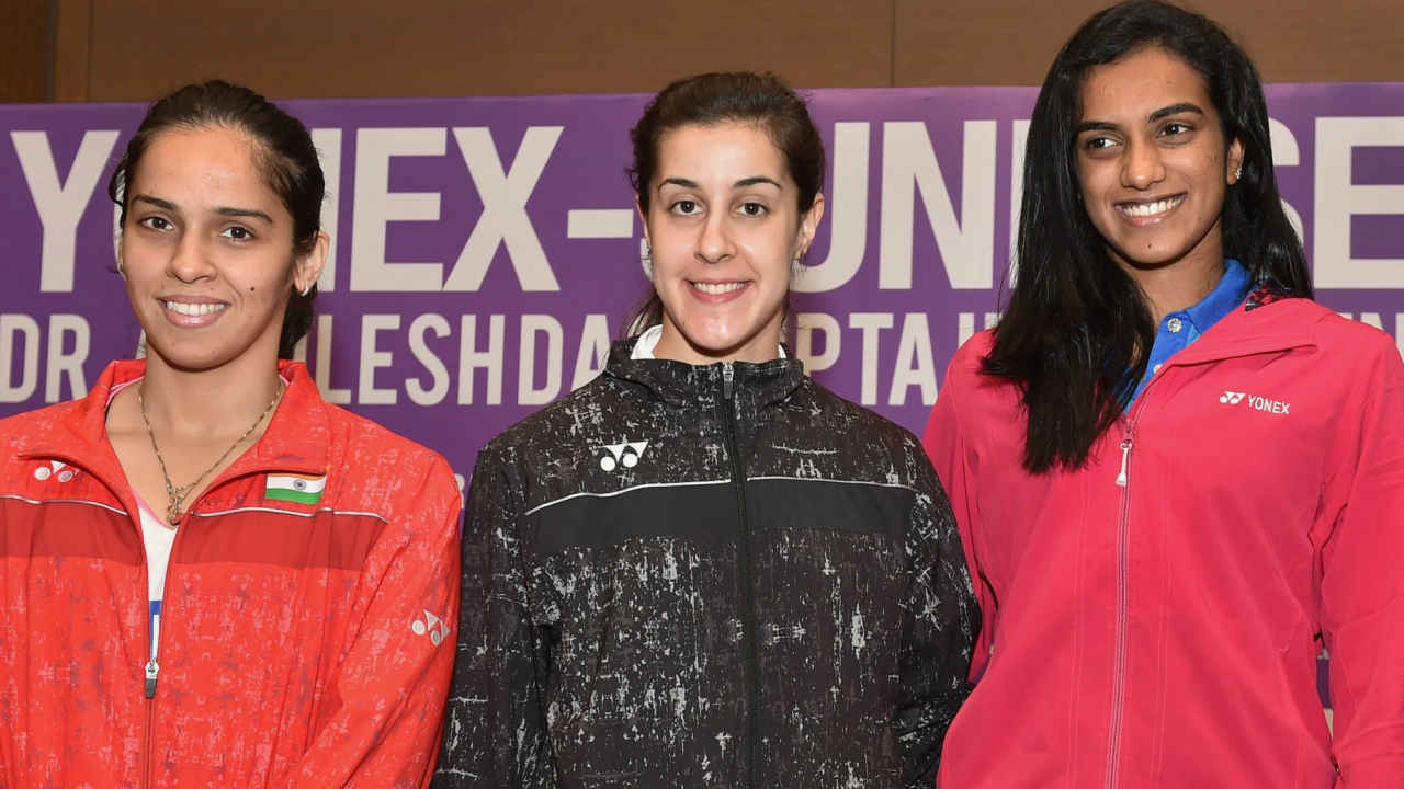 Indian shuttler Saina Nehwal, PV Sindhu and Spanish shuttler Carolina Marin pose for a photograph during a press conference of Dr Akhilesh Das Gupta India Open Badminton Championships, in New Delhi. (PTI)