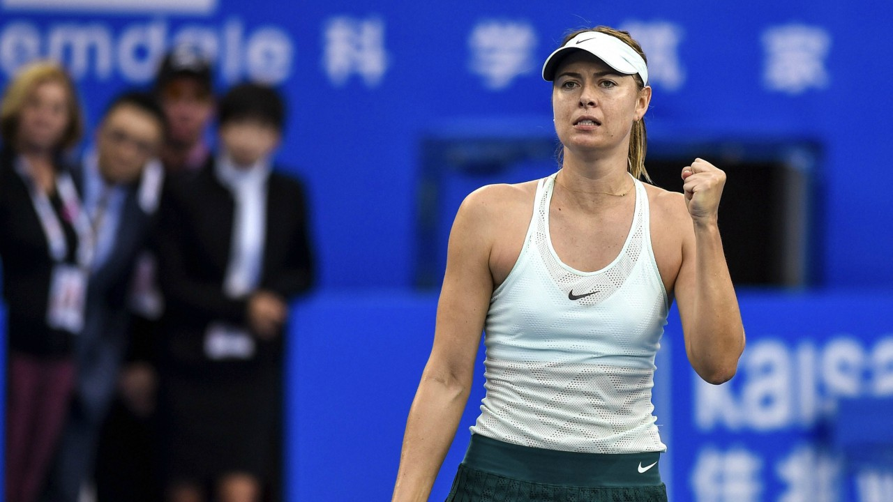 Maria Sharapova of Russia celebrates after winning a quarter final match against Zarina Diyas of Kazakhstan at the WTA Shenzhen Open tennis tournament in Shenzhen, south China's Guangdong Province (AP)