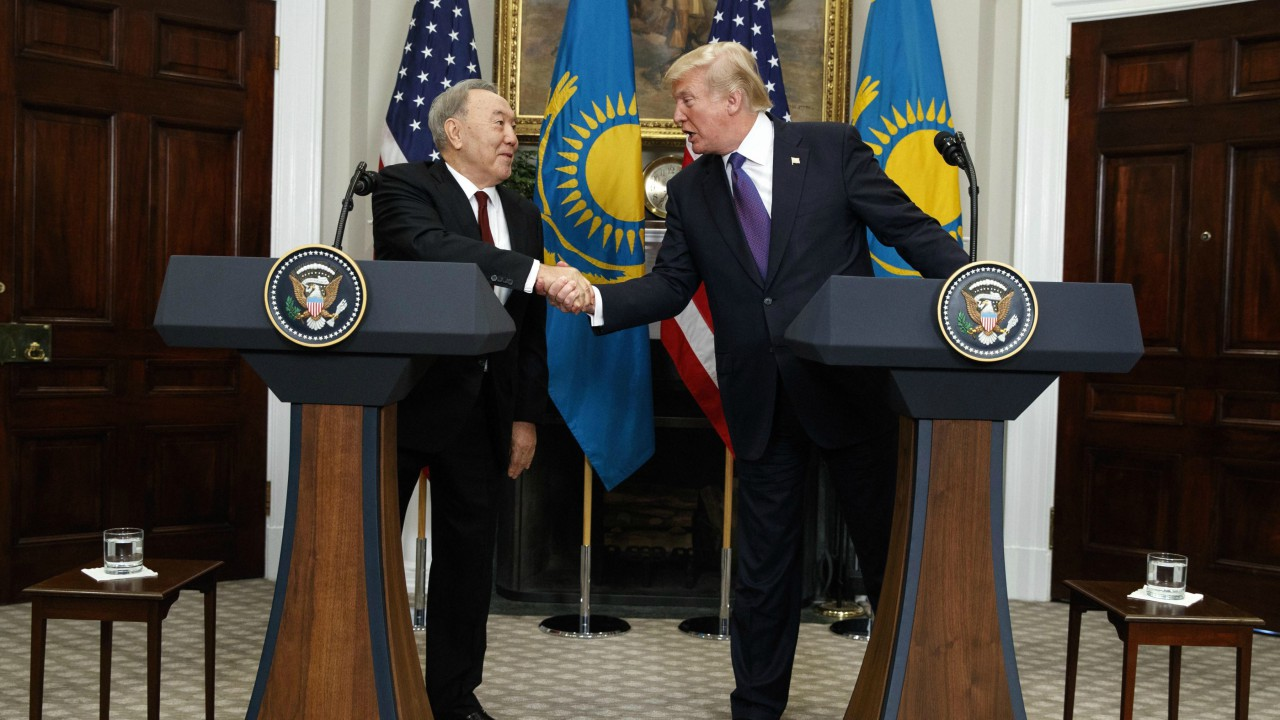 President Donald Trump shakes hands with Kazakhstan's President Nursultan Nazarbayev in the Roosevelt Room of the White House (AP)
