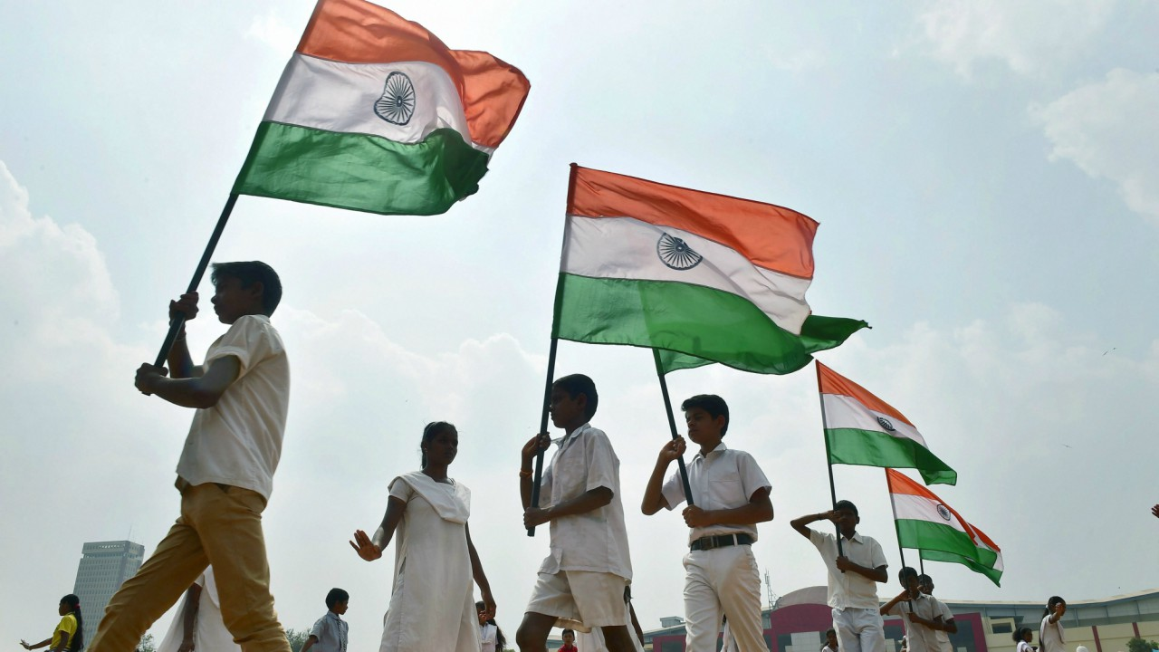 Students walk in formation with the Indian flag during full dress rehearsal ahead of Republic day celebration at Parade Ground in Bengaluru (PTI)