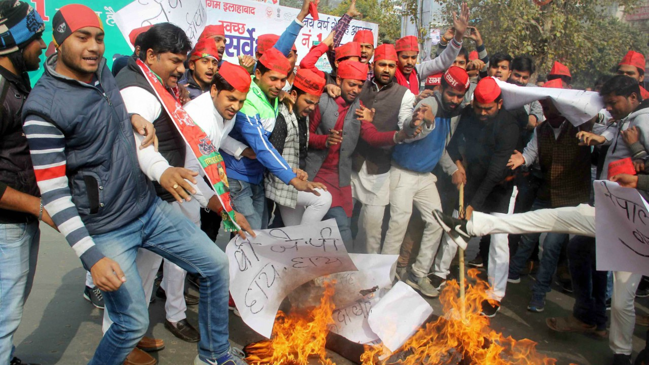 Samajwadi Party workers shouting slogans and burning the effigy of BJP MP Nepal Singh during a protest over his remarks, in Allahabad  (PTI)