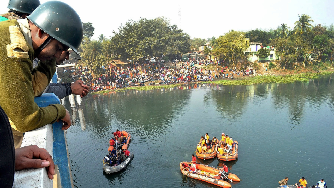 Rescue works underway on the second consecutive day after a public bus fell into the Bhairab river from a in Murshidabad district. (PTI)