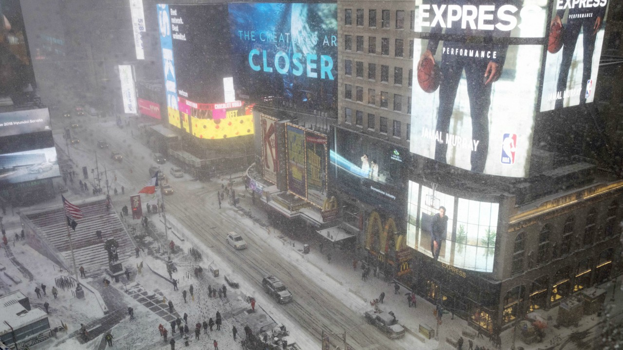 Snow falls over Times Square, Thursday, Jan. 4, 2018, in New York. A massive winter storm swept from the Carolinas to Maine on Thursday, dumping snow along the coast and bringing strong winds that will usher in possible record-breaking cold. (AP)