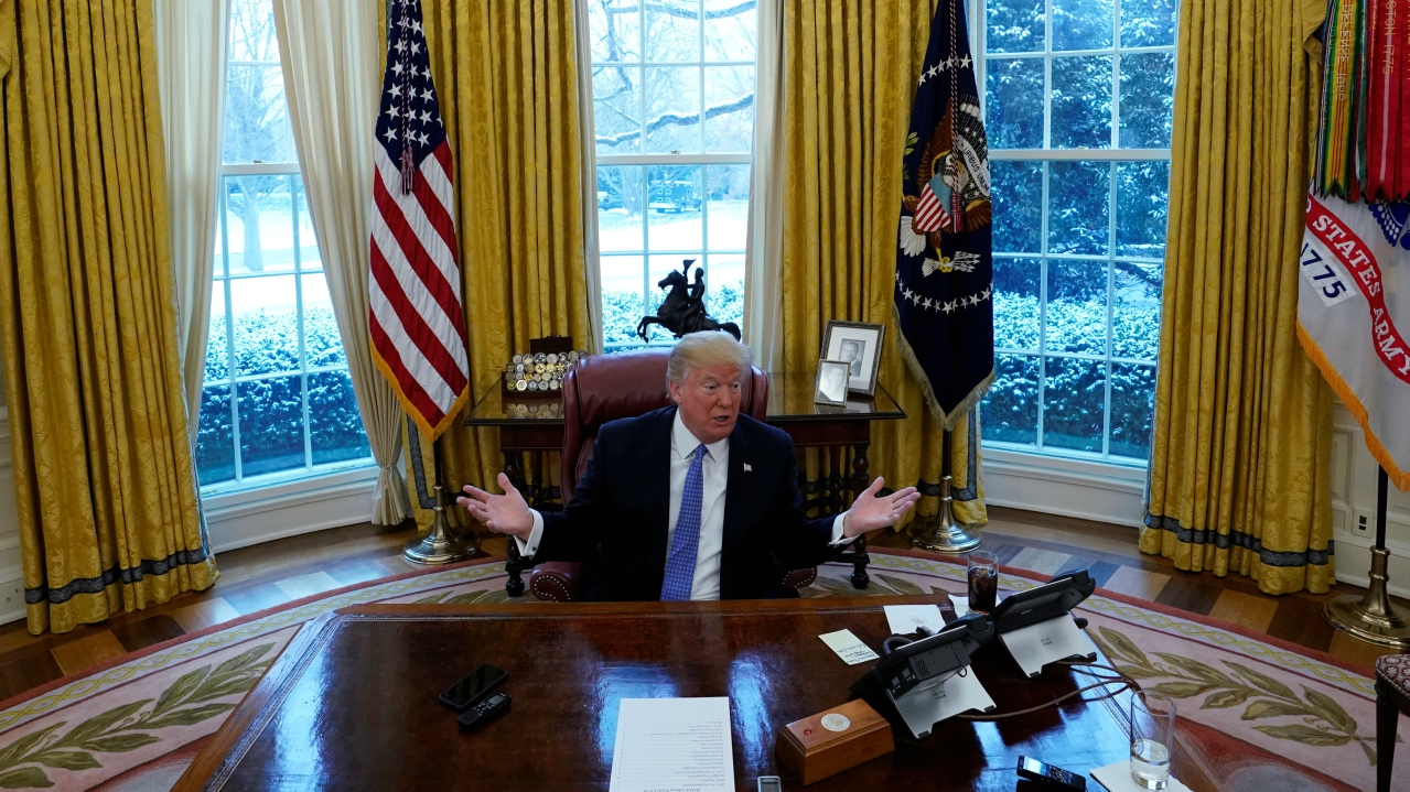 """On the 'button' on his desk 