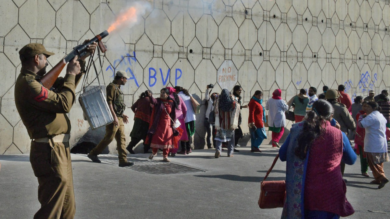 Police take action against the National Health Mission employees as they raise slogans during a protest rally, in Jammu. (PTI)