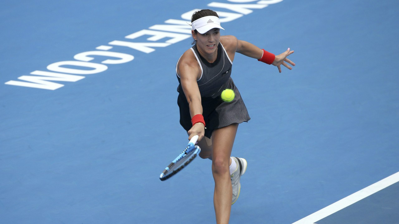 Garbine Muguruza of Spain hits a forehand to Kiki Bertens of Netherlands during their women's singles match at the Sydney International tennis tournament in Sydney. (AP/PTI)