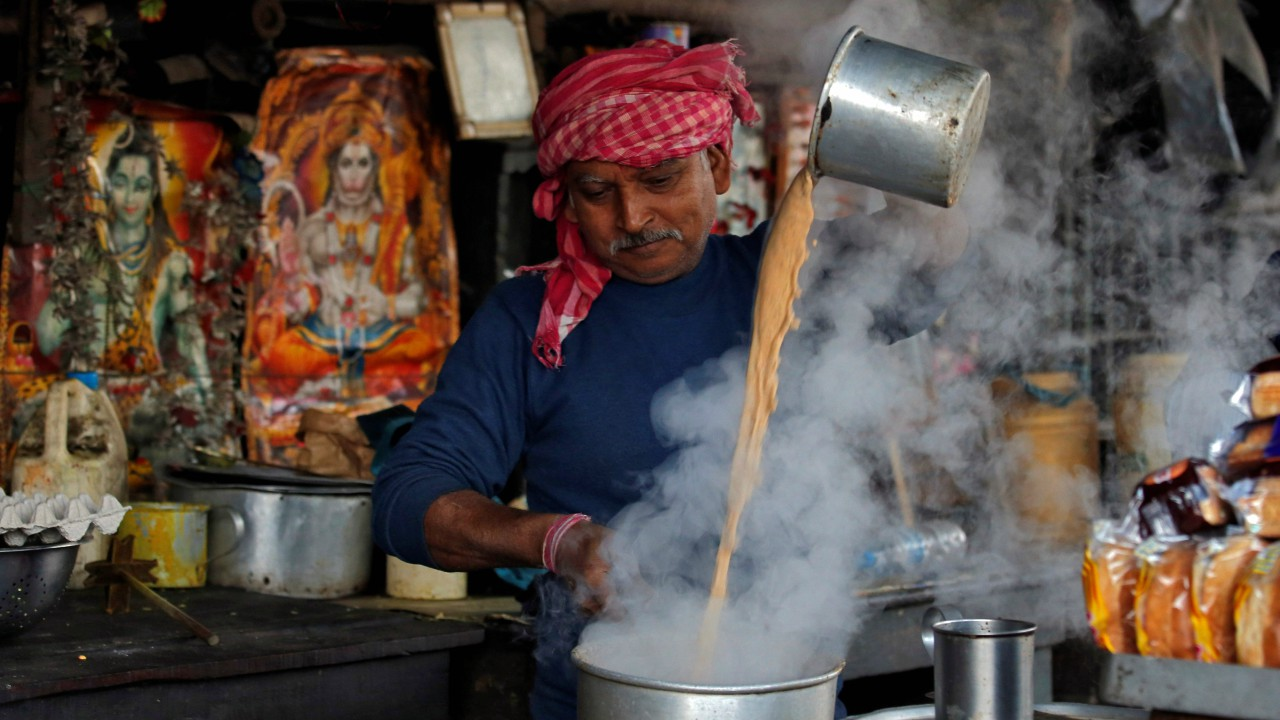 A man prepares tea at his roadside stall on a winter morning in Kolkata (REUTERS)