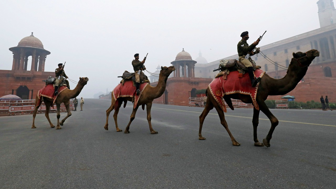 Members of the Indian Border Security Force (BSF) ride their camels during rehearsals for the Republic Day parade on a winter morning in New Delhi, India (REUTERS)
