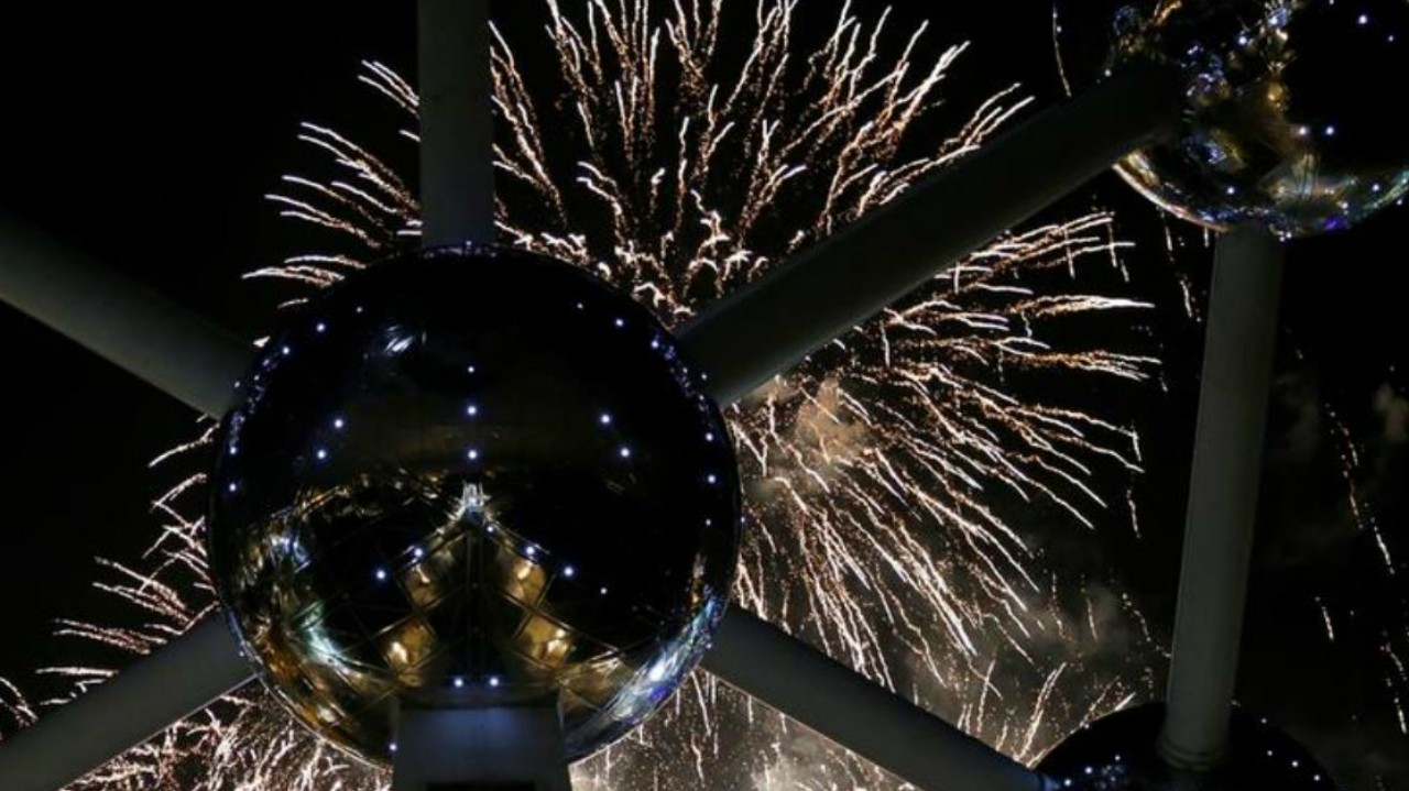 Fireworks light up the Atomium building, a metal structure built in the form of a crystal of iron, as part of new year celebrations in Brussels, Belgium (REUTERS)