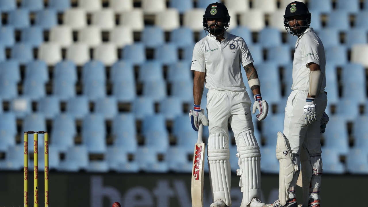 India's captain Virat Kohli, left, chats with teammate Cheteshwar Pujara while awaiting a decision for his LBW review on the fourth day of the second cricket test match between South Africa and India at Centurion Park in Pretoria, South Africa (AP/PTI)