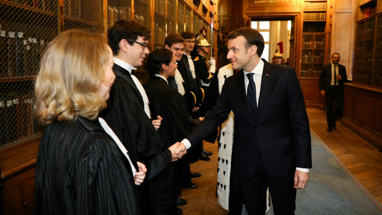 French President Emmanuel Macron (R) shakes hands with newly-appointed magistrates during the Court of Auditors' solemn hearing to mark the beginning of the year in Paris, France (REUTERS)