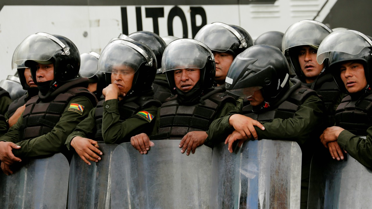 Riot policemen are seen in front of Health Ministry building before a protest against Bolivia's government new health care policies in a main avenue of La Paz, Bolivia (REUTERS)