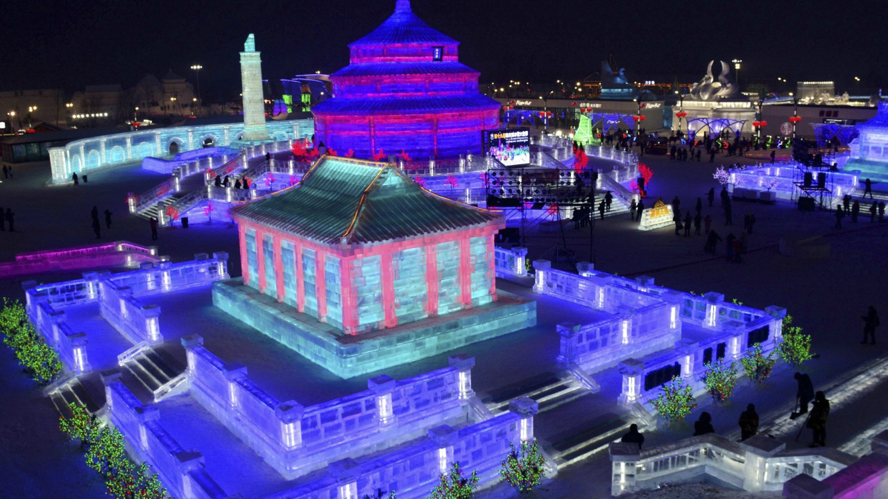 Visitors walk among the attractions at the Harbin International Ice and Snow Festival in Harbin in northeastern China's Heilongjiang Province. The Harbin International Ice and Snow Festival is known for massive, elaborate and colorfully lit ice sculptures featuring animals, cartoon characters and famous landmarks. (AP)