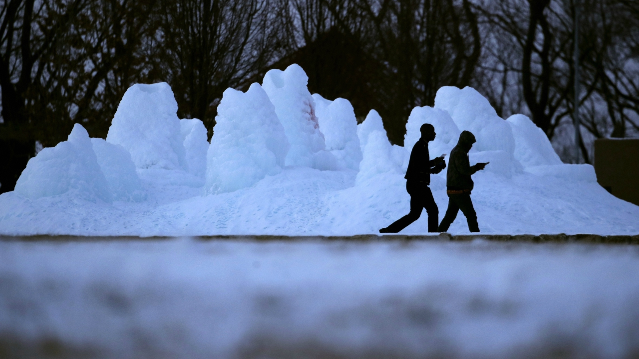 People walk past a frozen fountain in Kansas city. (AP/PTI)