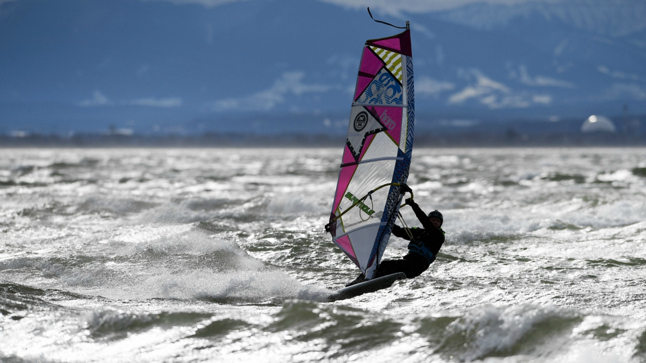 """Surfers can be seen on Ammersee Lake as the storm """"Friederike"""" rages on all over Germany, in Herrsching, Germany. (AP/PTI)"""
