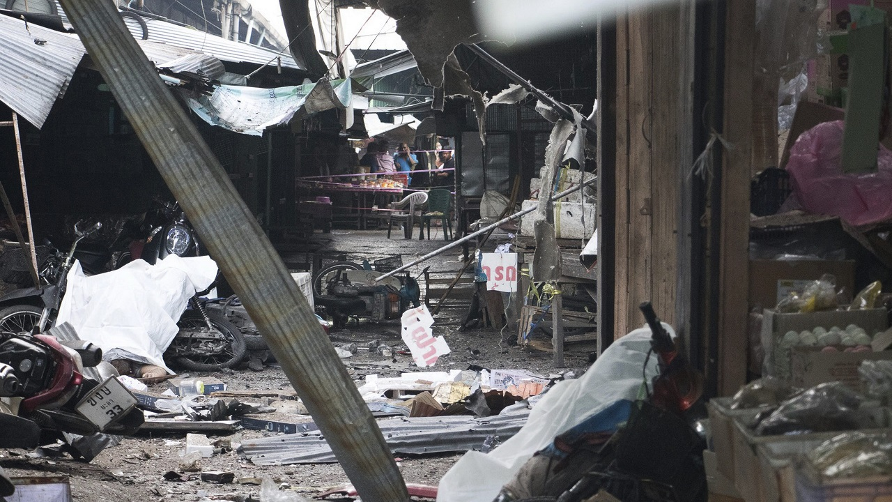Villagers watch the site of a bombing at a market in Yala province in southern Thailand. Police say a few people have been killed by the explosion. (AP/PTI Photo)