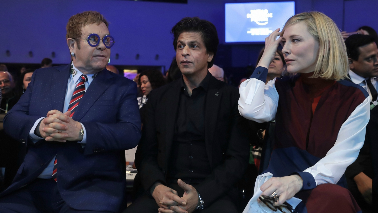British musician Elton John, Indian actor Shah Rukh Khan and Australian actress Cate Blanchett, from left, wait for the ceremony for the Crystal Awards on the eve of annual meeting of the World Economic Forum in Davos, Switzerland. (AP/PTI)