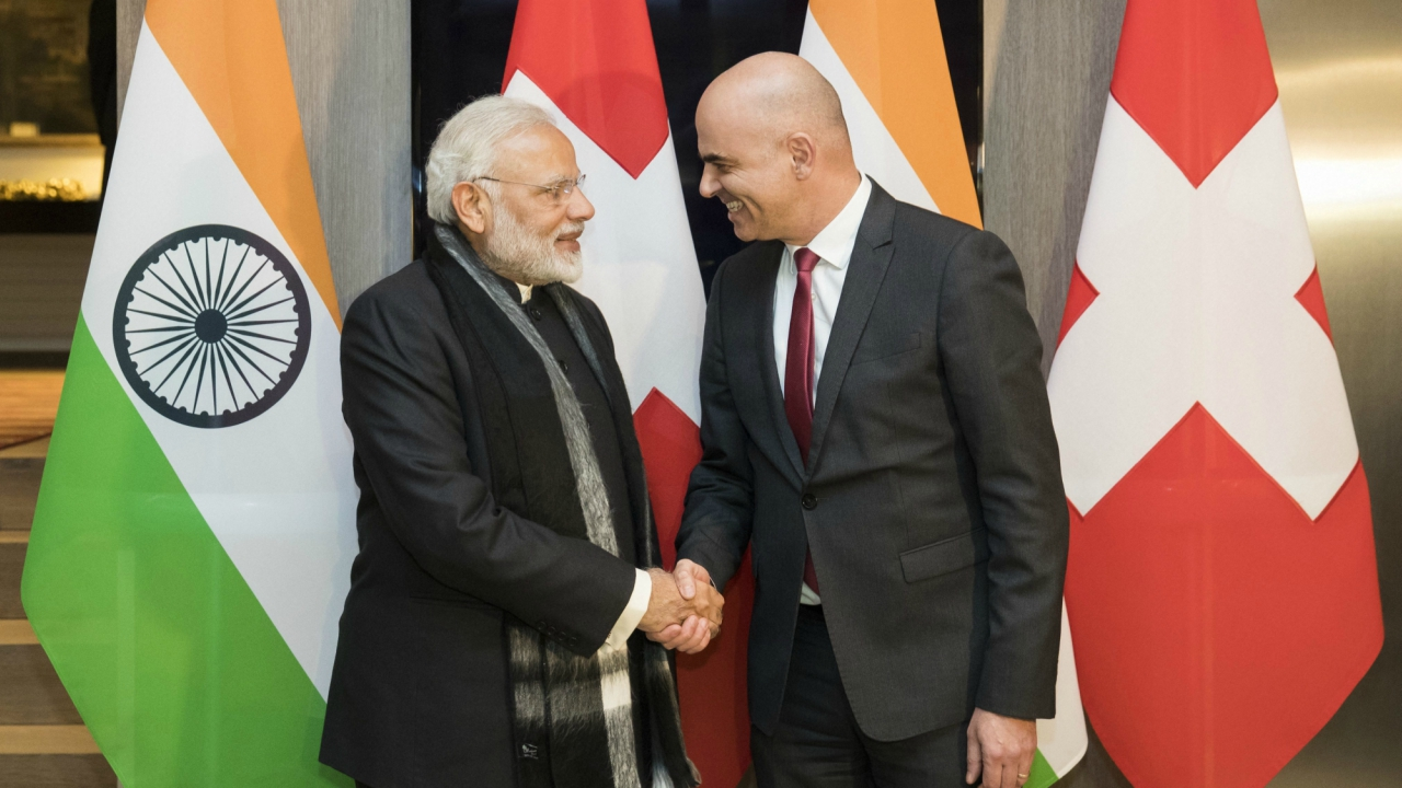 Prime Minister Narendra Modi with Swiss Federal President Alain Berset before the start of the WEF annual meet, in Davos on Monday. The meeting brings together entrepreneurs, scientists, chief executive and political leaders here. (AP/PTI)