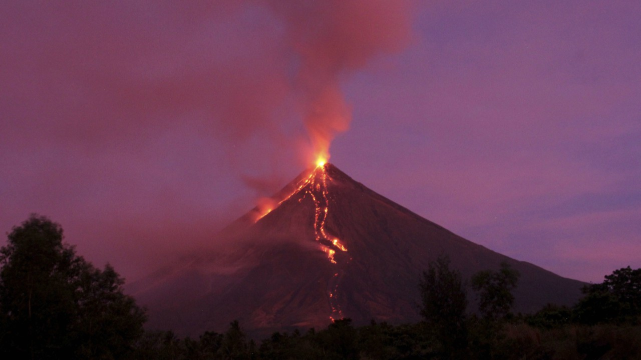 Molten lava flows down the slopes of Mayon volcano during its mild eruption as seen from Legazpi city, Albay province, southeast of Manila, Philippines Tuesday, Jan. 30, 2018. Mayon's lava fountaining has flowed up to 3 kilometers (1.86 miles) from the crater in a dazzling but increasingly dangerous eruption (AP/PTI)