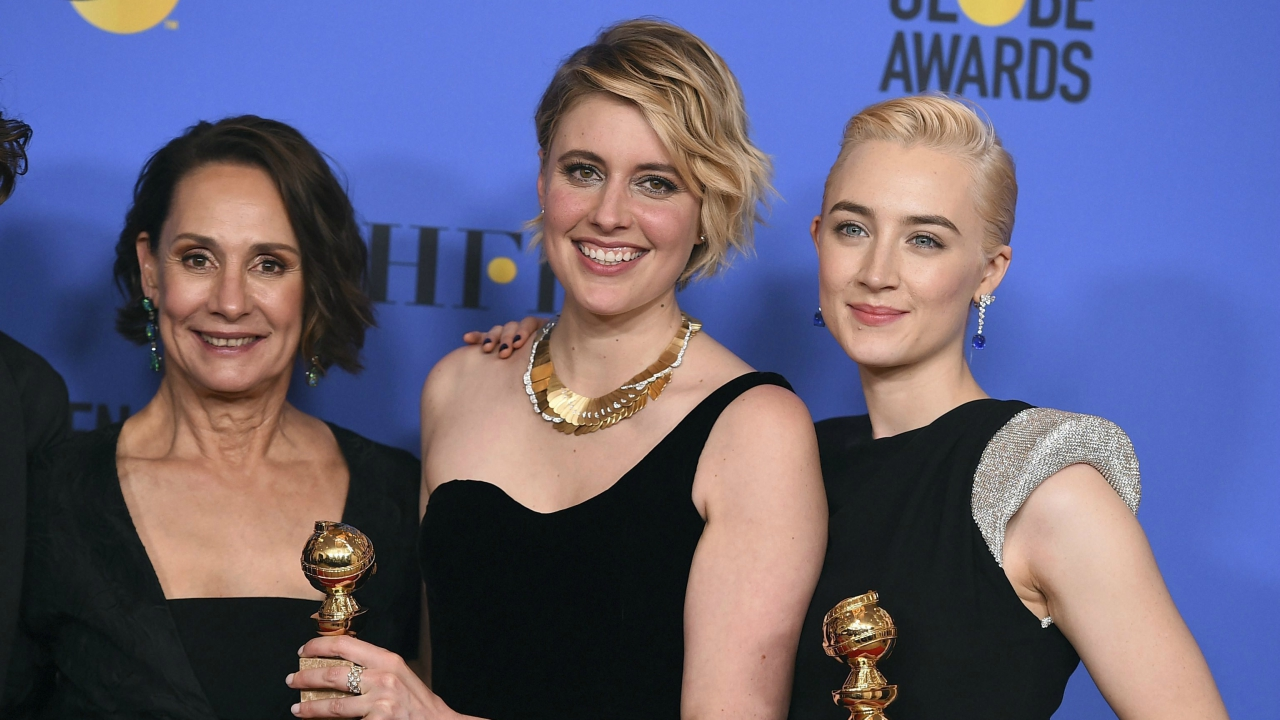 "Laurie Metcalf, from left, Greta Gerwig and Saoirse Ronan, winners of the award for best motion picture - musical or comedy for ""Lady Bird"" (Source: PTI)"