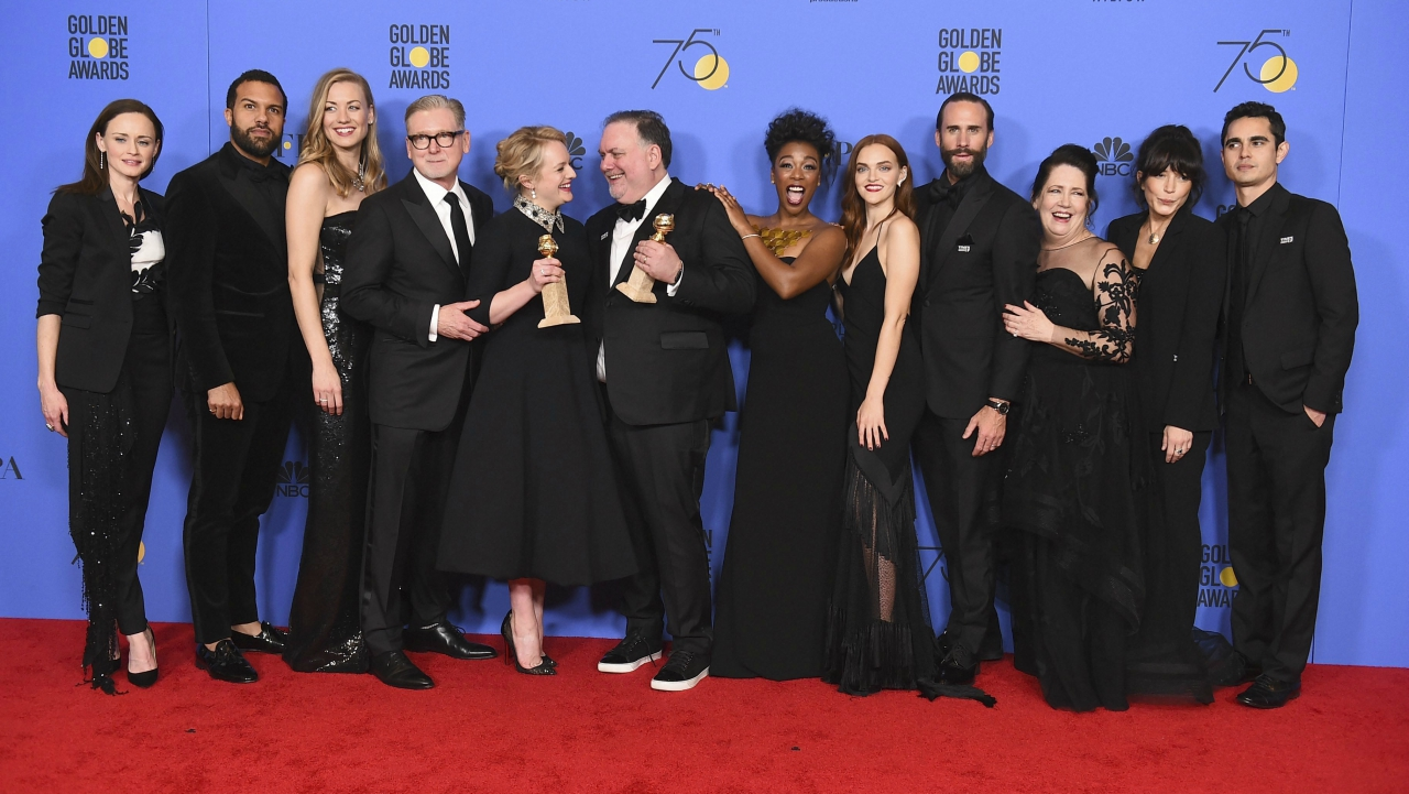"The cast and crew of ""The Handmaid's Tale"" pose with the award for best television series - drama (Source: PTI)"