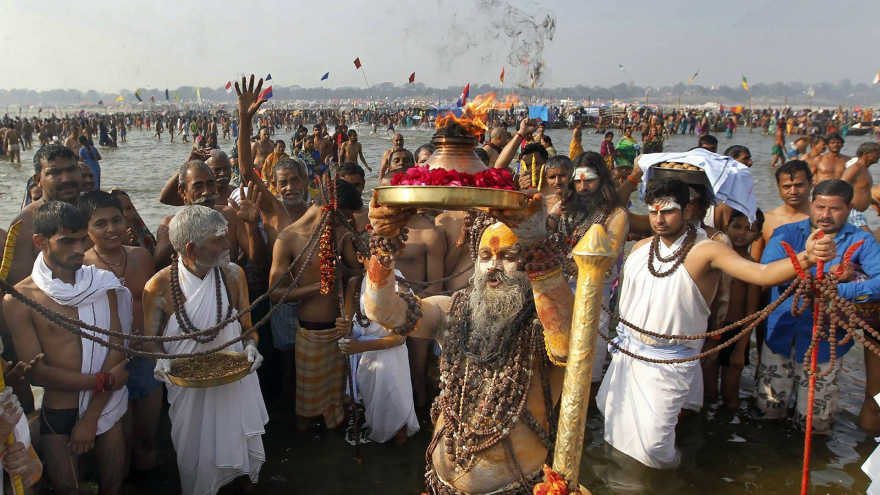 A sadhu or holy man offering prayers after taking holy dip at Sangam on the occasion of Makar Sankranti festival during Magh mela in Allahabad. (PTI)