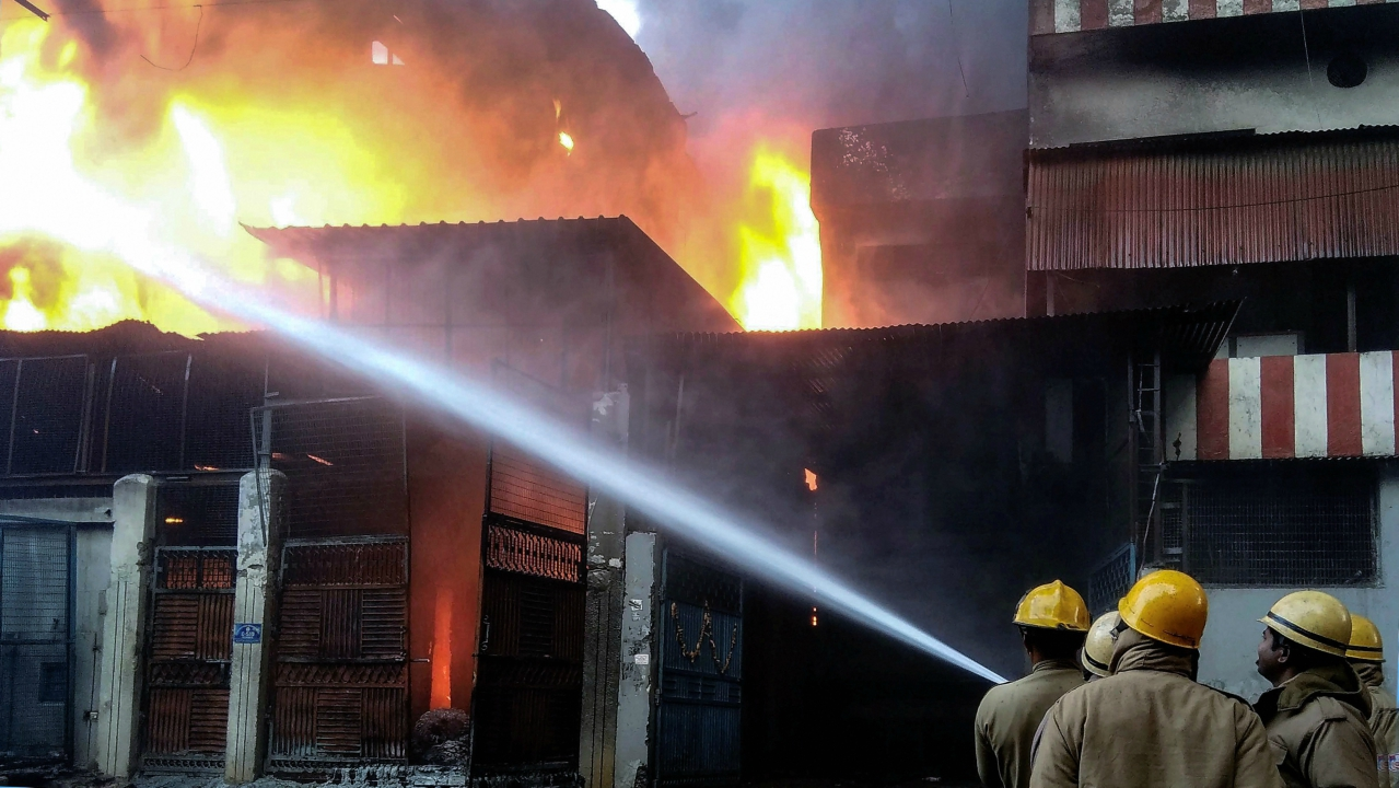 Firefighters dousing a fire which broke out at a plastic factory at Bhorgarh Narela Industrial area in Delhi. (PTI)
