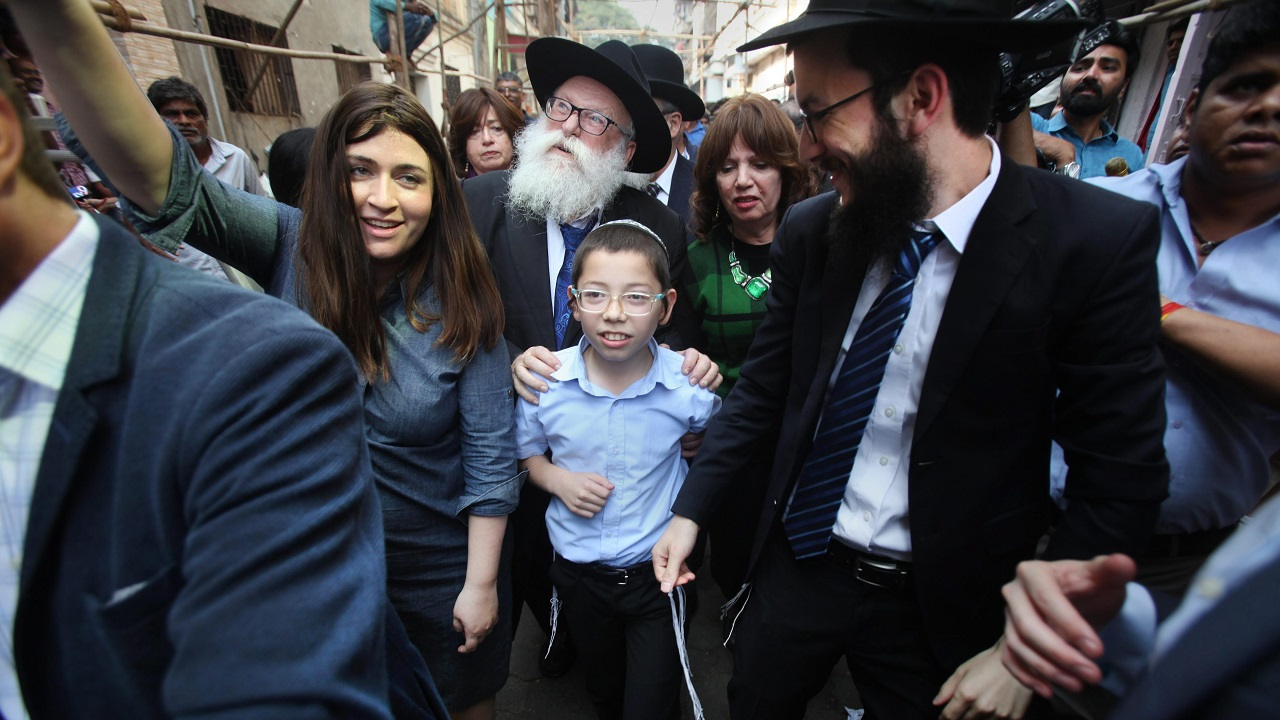 Moshe Holtzberg, who lost his parents during the 26/11 terror attacks, arrives at Nariman House in Mumbai. (PTI)