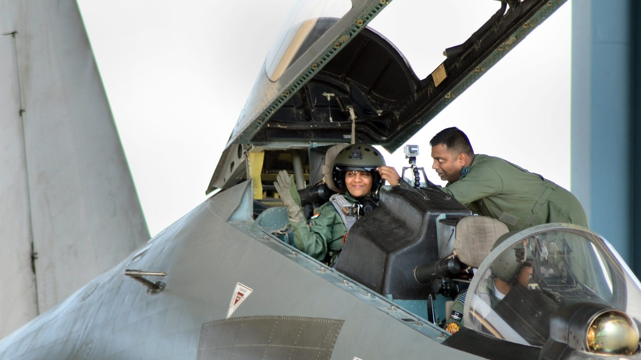 Defence Minister Nirmala Sitharaman waves from the cock-pit of IAF's Sukhoi-30 MKI plane before taking off for a sortie in Jodhpur. (PTI)
