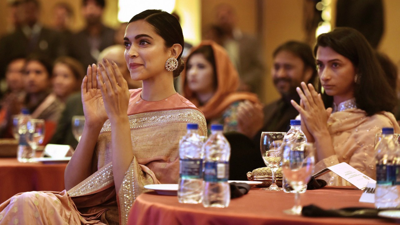 Actress Deepika Padukone during presentation of BAI's Lifetime Achievement Award to her father Prakash Padukone at a function in New Delhi on Monday (PTI)