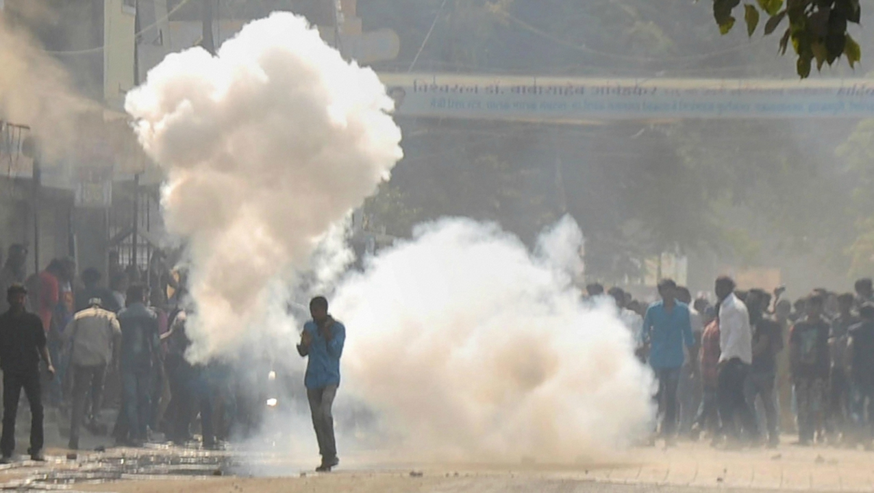 RPI activists, amid teargas, pelting stones at the police during their violent protest in Aurangabad on Tuesday. (PTI)