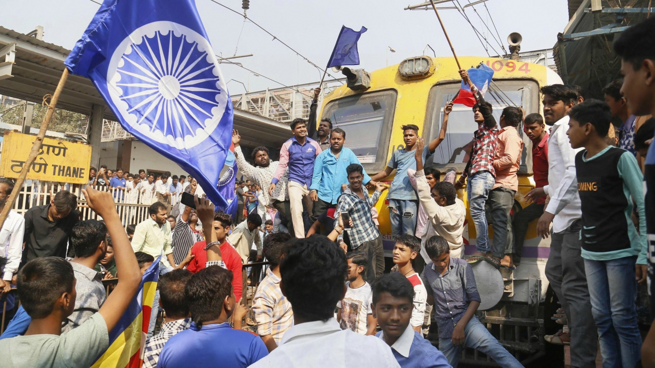 Dalit groups protesting at Thane railway station. (PTI)