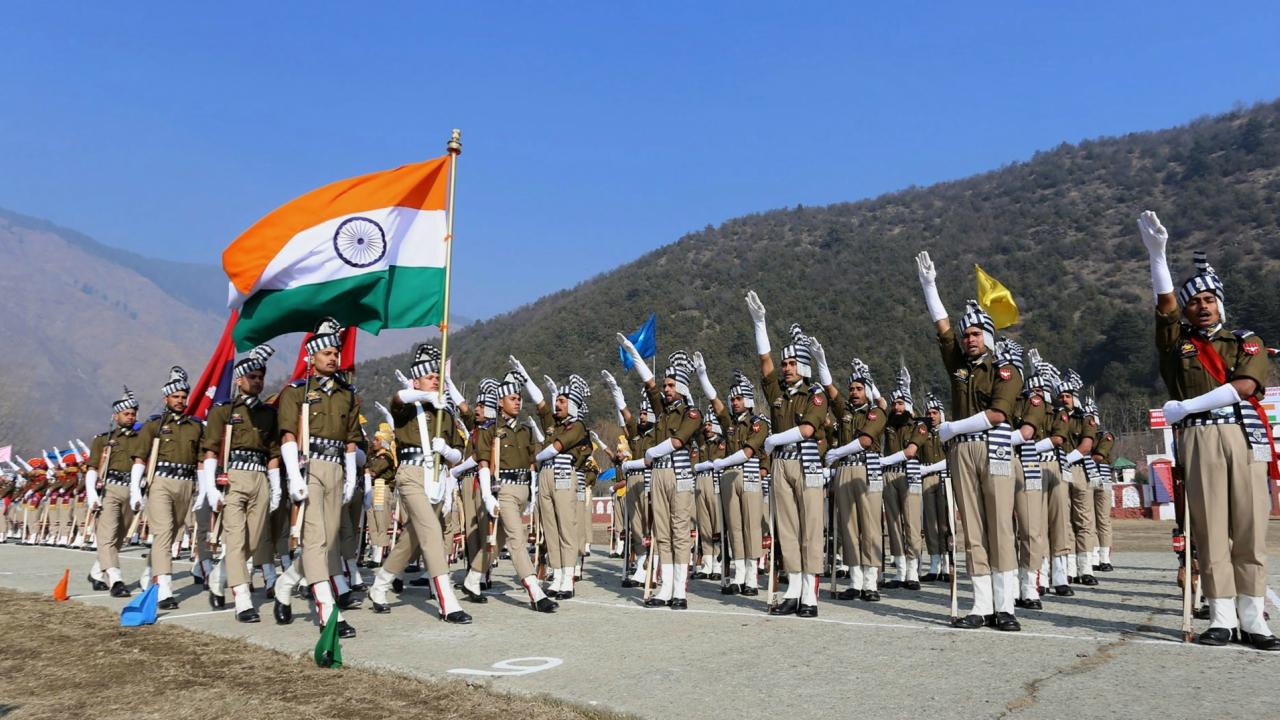 New recruits of Jammu and Kashmir Police personnel take oath during Attestation Cum Passing Out Parade at STC Sheeri in Baramulla district of north Kashmir on Sunday. (PTI Photo)