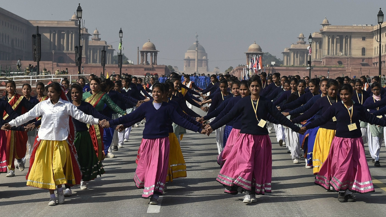 Schoolchildren perform during a rehearsal for the Republic Day parade, at Rajpath in New Delhi on Sunday. (PTI Photo)