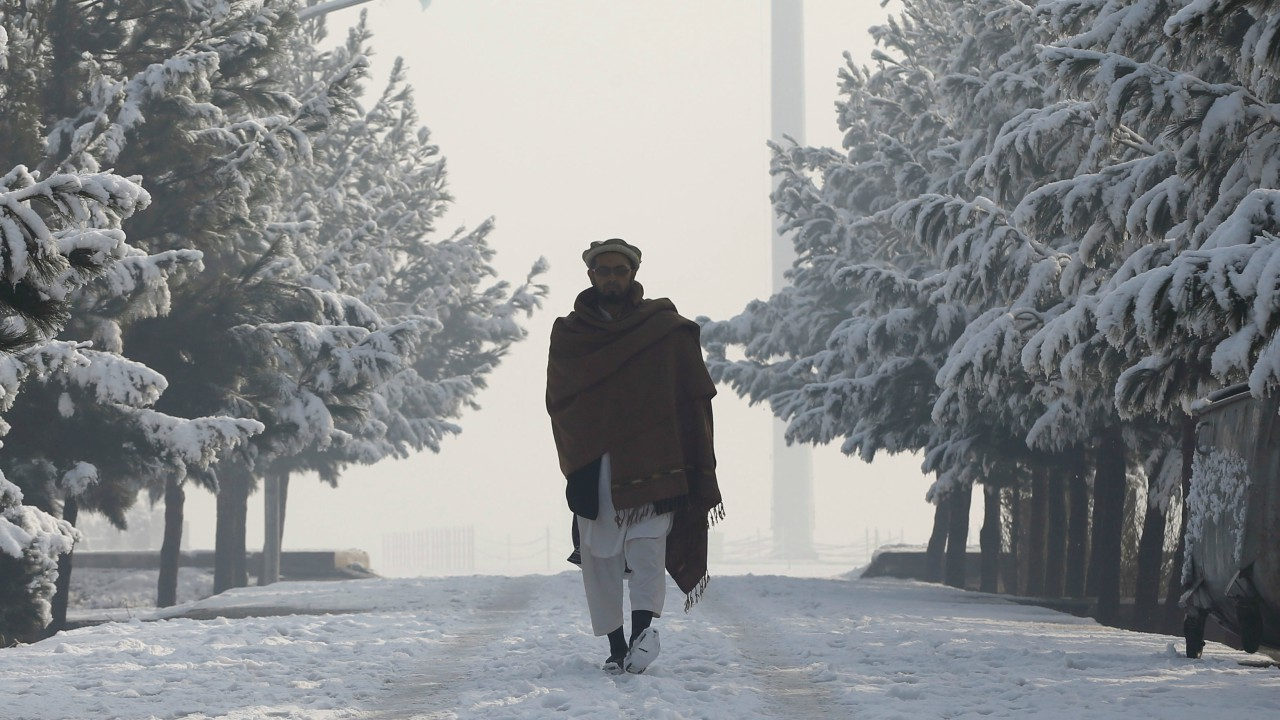 A man walks through snow covered ground in Kabul, Afghanistan (REUTERS)