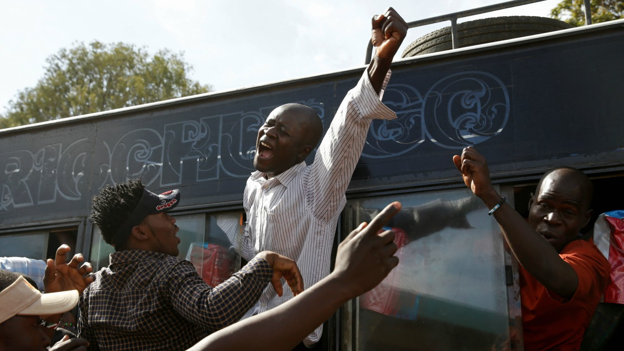 Supporters of Kenyan opposition leader Raila Odinga of the National Super Alliance (NASA) coalition gesture through a bus window ahead of his planned swearing-in ceremony as the President of the People's Assembly in Nairobi, Kenya (REUTERS)