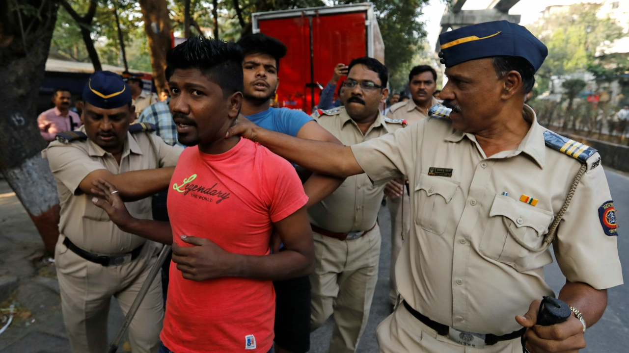 Members of the Dalit community are detained by police during a protest. (Reuters)