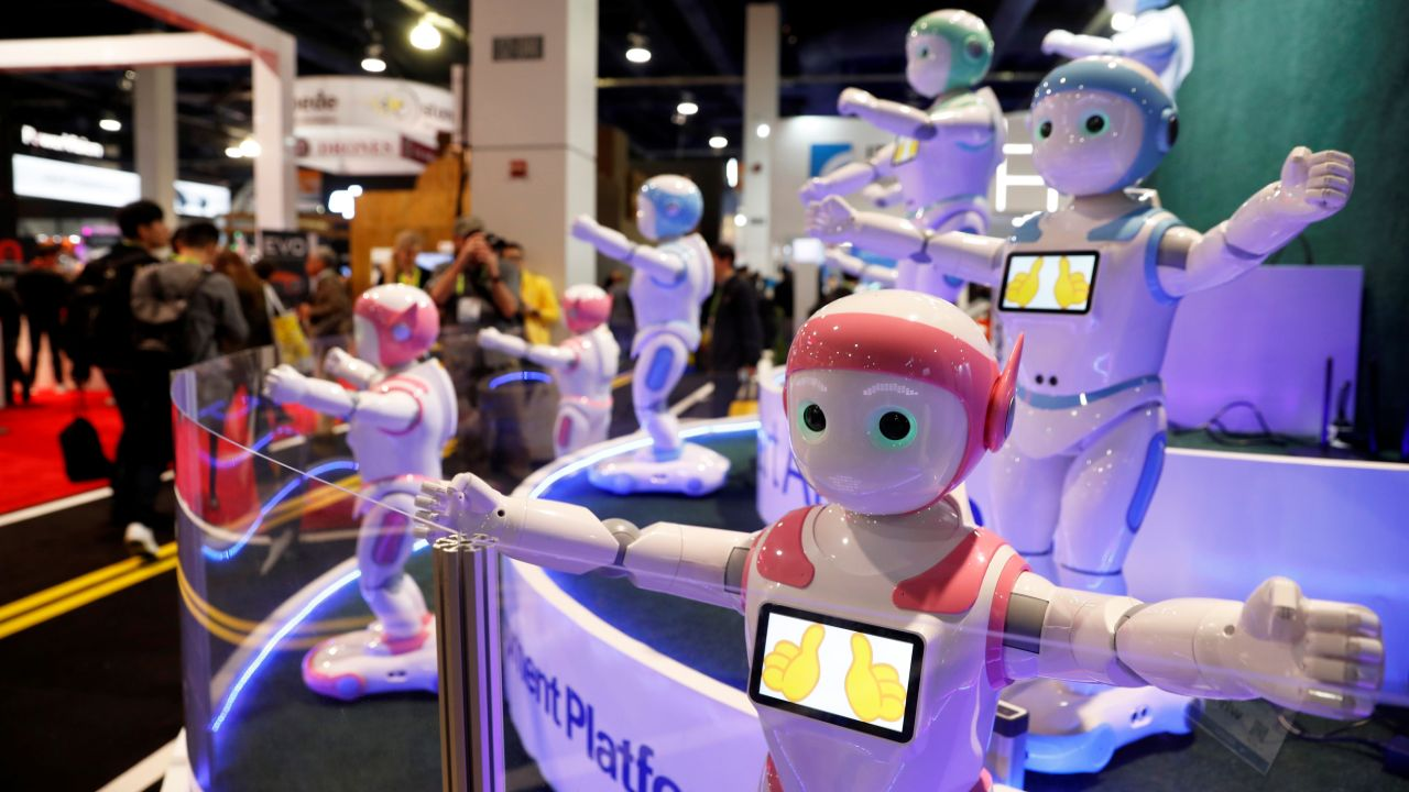 Avatarmind's iPal Smart AI Robots, designed to be companions for children and elderly, perform calisthenics during the CES 2018. (Reuters)