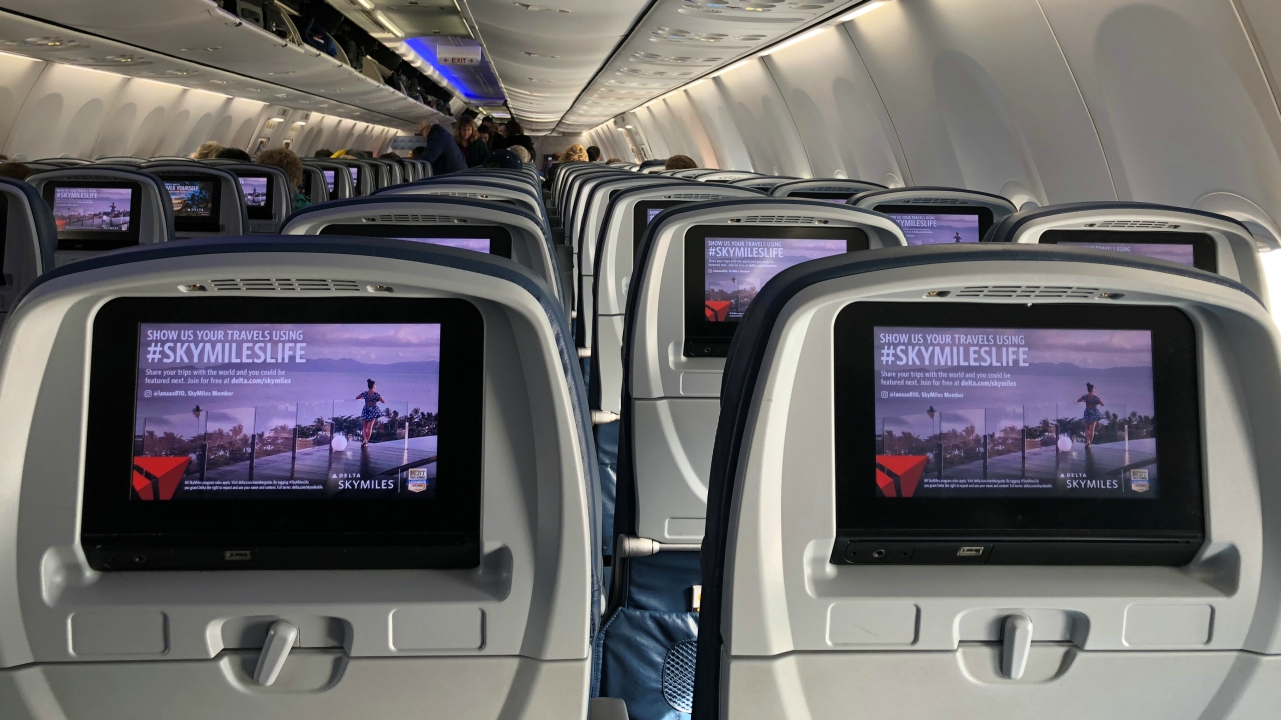 Video screens are shown built into the backs of passenger seats onboard a Delta Airlines Boeing 737-900ER aircraft in San Diego, California, US. (Reuters)
