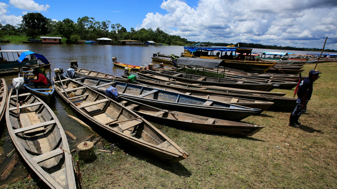Boats are seen on the banks of the Amazon river after the signing of a document by Colombia's President Juan Manuel Santos that will allow for the conservation of the Tarapoto wetland complex in Amazonas, Colombia. (Reuters)
