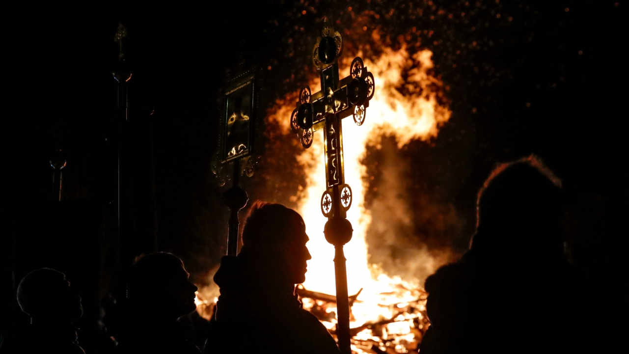 People participate in a service during Orthodox Epiphany celebrations in the village of Drachevo, outside Moscow, Russia. (Reuters)