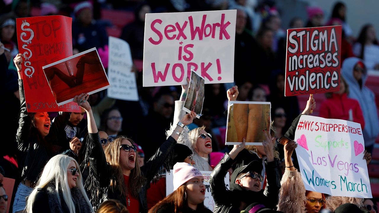 Women cheer a speaker during the Women's March rally in Las Vegas, Nevada, United States. (Reuters)