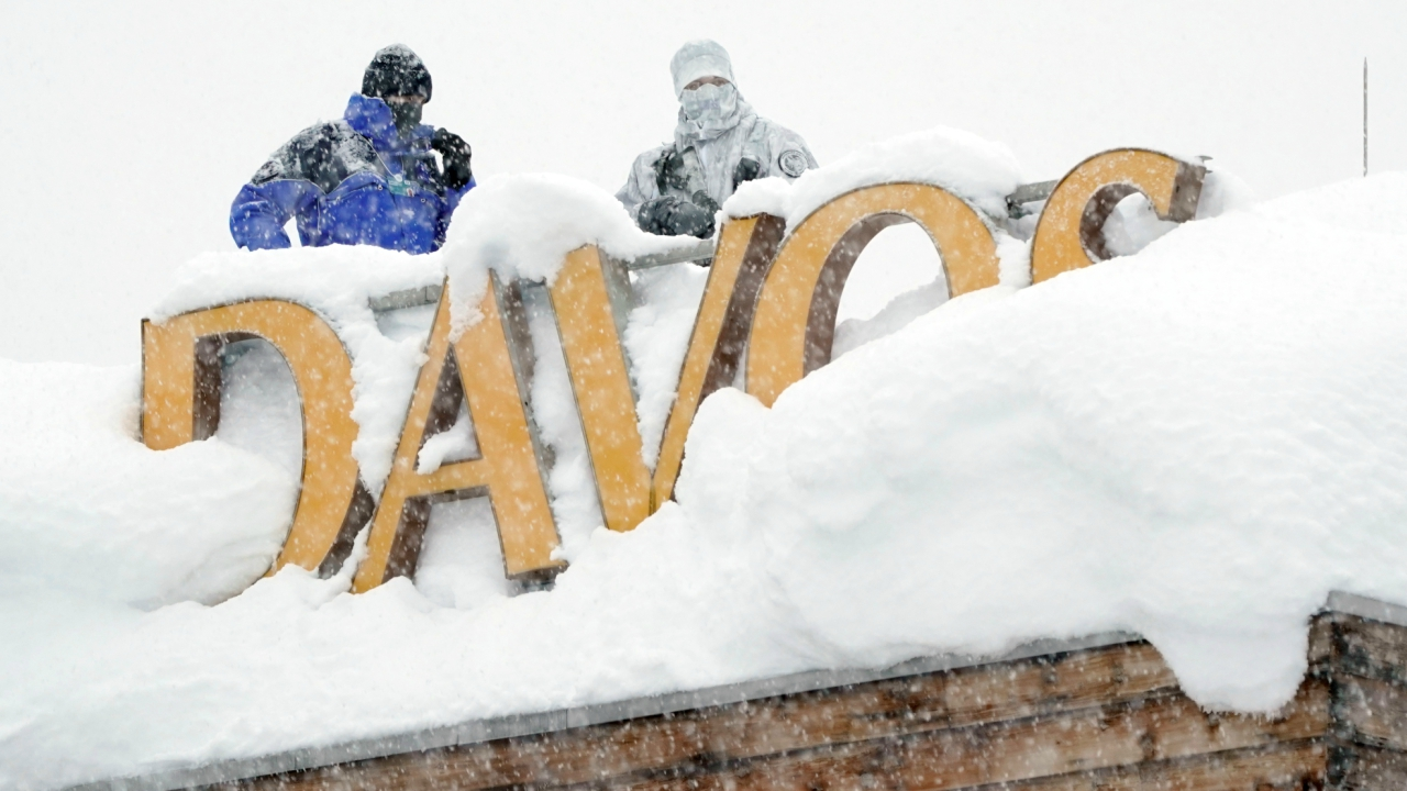 As the World Economic Forum Summit in Davos kicks off today, snipers hold their position on the roof of a hotel for security services. (Reuters)
