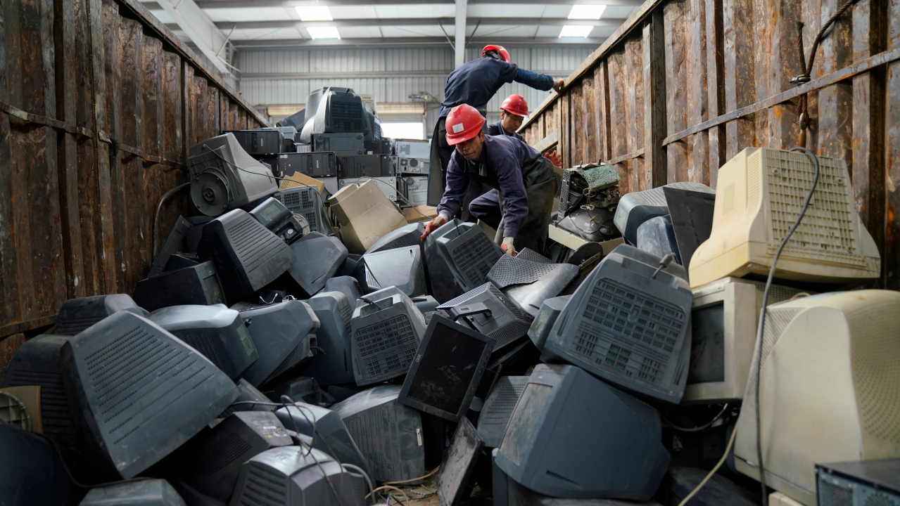 Monitors about to be recycled are seen in a warehouse at the government-sponsored recycling park in the township of Guiyu, Guangdong Province, China. (Reuters)