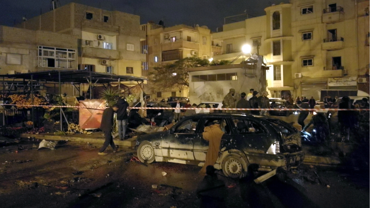 People gather at the site of twin car bombs in Benghazi, Libya. (Reuters)