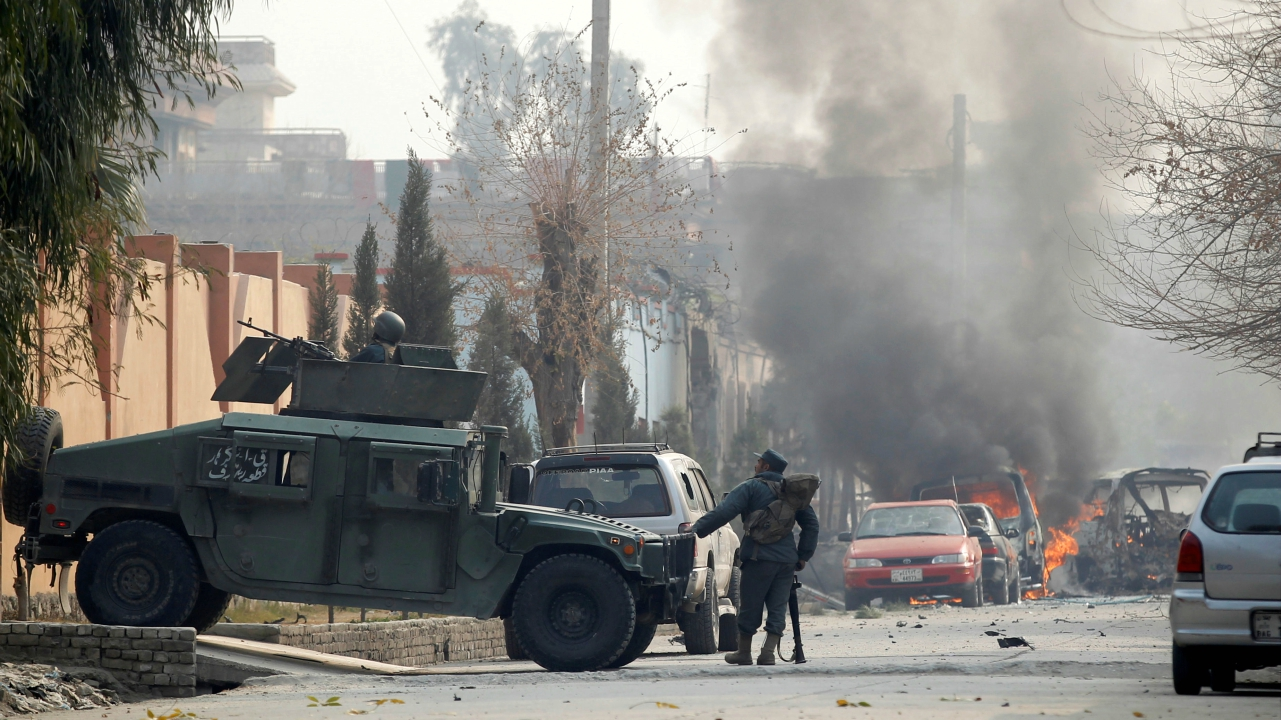 Afghan police officers arrive at the site of a blast and gun fire in Jalalabad, Afghanistan. (Reuters)
